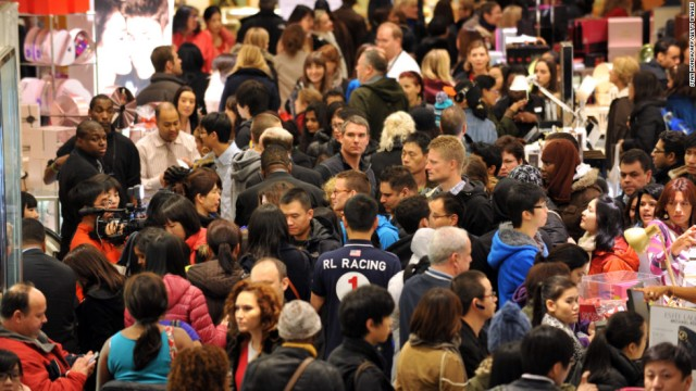 In this image from CNN, shoppers fight their way through Macy's in New York last Black Friday.