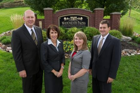 Ora Reynolds, second from left, and the members of the Hunt Midwest residential division, Brenner Holland, general manager; Jenni Mann, manager of residential marketing; and Aaron Schmidt, director of planning and construction.