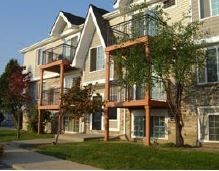 An exterior view of the Aspen Chase apartments in Ypsilanti Township, Mich.