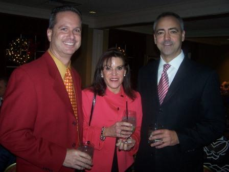 CBRE's John Latessa -- on the right -- celebrates the holidays with his co-workers.