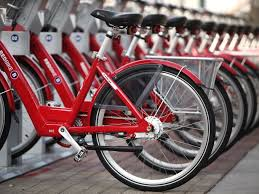 The Red Bike bike-share program is one amenity that is attracting young people to downtown Cincinnati.