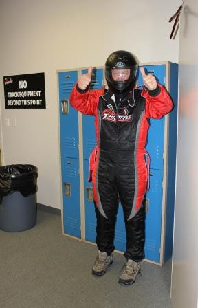 Garrett getting ready for a go-kart race with his Colliers colleagues.