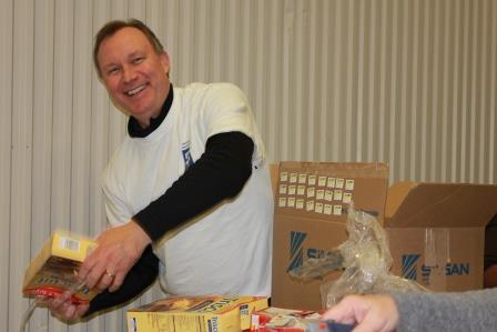 Colliers' Columbus office does plenty of volunteer work. Here, Jim Garrett is packing food at the Mid-Ohio Food Bank.