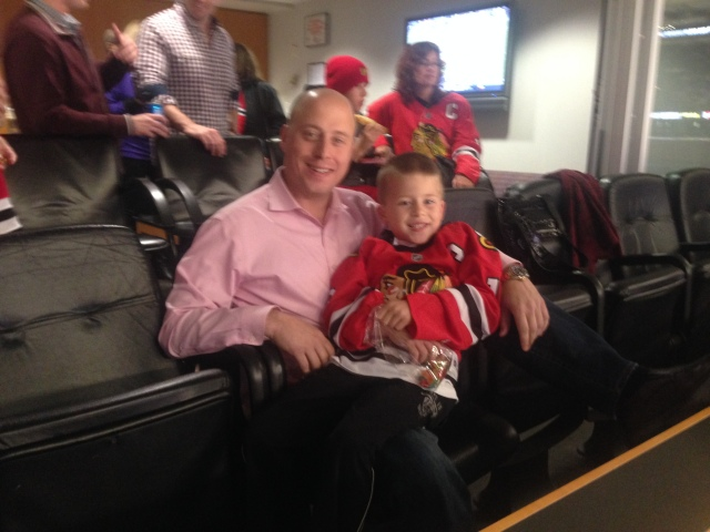 Brown and his son Tyler enjoy a Blackhawks game.