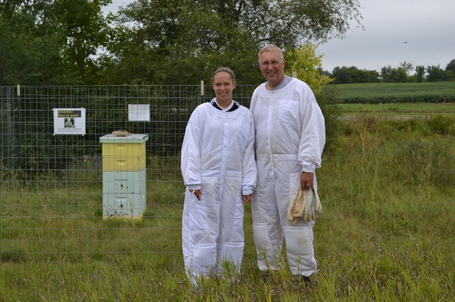 Craig Francois, his daughter Rebecca and his bees, at least some of them.